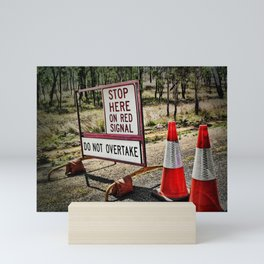 Stop on the red light - roadworks sign. Mini Art Print