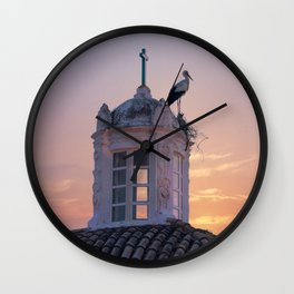 A stork's nest on a church turret at sunset, Portugal, the Algarve, Faro Wall Clock