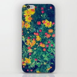 Vibrant floral blossoming in yellow, green, blue and red iPhone Skin