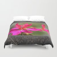 grafitti Duvet Covers featuring Zonal Stellar Geranium named Grafitti Violet by JMcCombie