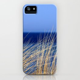Dried long grass with blue sea behind and blue sky iPhone Case
