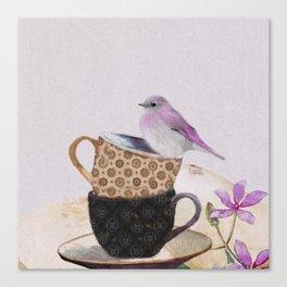 Bird in tea cup Canvas Print
