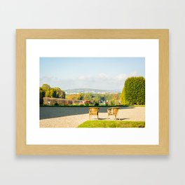 A couple of chairs on the top of a lookout watching the landscape I Framed Art Print