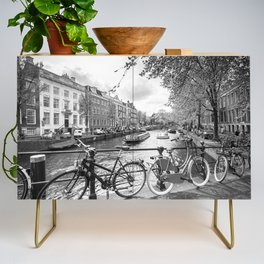 Bicycles parked on bridge over Amsterdam canal Credenza