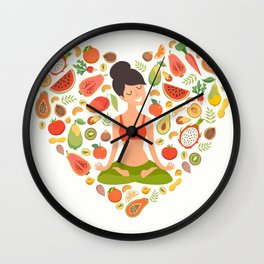 Yoga pose, lotus position. Beautiful girl in the lotus position. Nutrition concept. Healthy natural Wall Clock