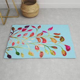 Red and Green Leaves on Light Blue Rug