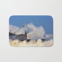 Stormy wave over lighthouse and pier of San Esteban de Pravia Bath Mat