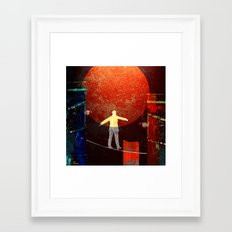 Tightrope walker in the city Framed Art Print