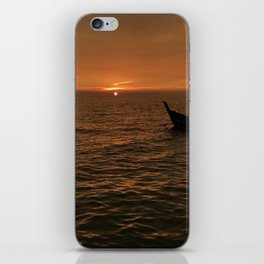 Sunset view with small boat, sampan at the seaside iPhone Skin
