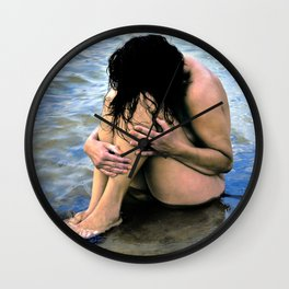 Sitting Woman, hiding herself on water-ground Wall Clock