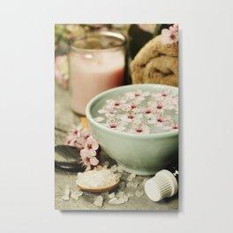 Spa setting. Sea salt, candles, floating flowers, towels on rustic background Metal Print