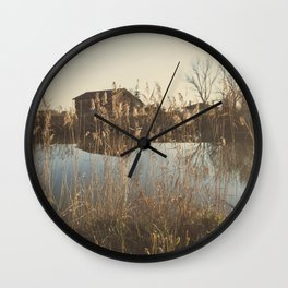 A cottage along a river Wall Clock