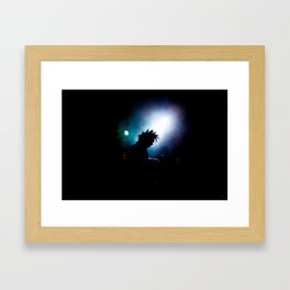 silhouette of a punk rock artist in the spotlight Framed Art Print