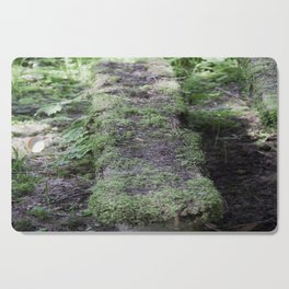 Nature reclaiming picnic bench Cutting Board
