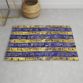 Golden Egyptian  hieroglyphs pattern on  blue Rug