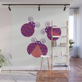 Three purple ladybugs over light yellow background Wall Mural