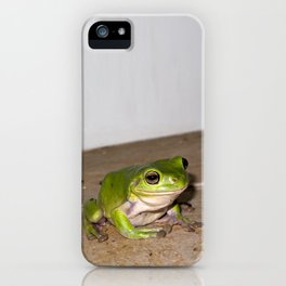 A beautiful green tree frog sitting on tiles iPhone Case