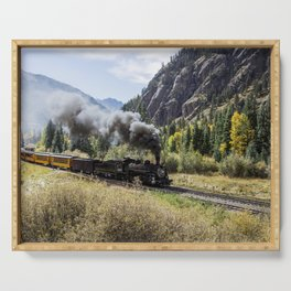 Scenic Railroad train pulled by a vintage steam locomotive chugs through the San Juan Mountains in t Serving Tray