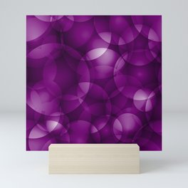 Dark intersecting purple translucent circles in bright colors with a blueberry glow. Mini Art Print