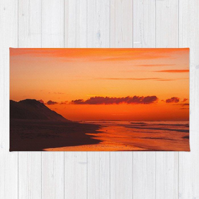 Sunset on the coast Rug