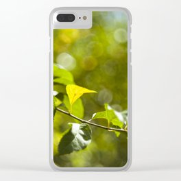 Green leaves and bokeh effect Clear iPhone Case