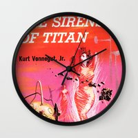 vonnegut Wall Clocks featuring Vonnegut -  The Sirens of Titan by Neon Wildlife