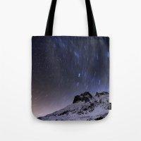 night sky Tote Bags featuring Night sky by Mila Pechenyakova