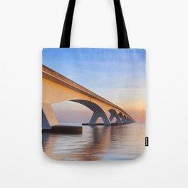 The Zeeland Bridge in Zeeland, The Netherlands at sunrise Tote Bag