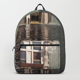 Modern fountain with water splashes on a huge glass window Backpack