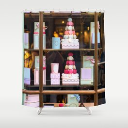 Beautiful colorful tasty macaroons cakes sweets and presents in the boxes display in window at the  Shower Curtain