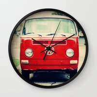 vw bus Wall Clocks featuring Red VW Bus by Anna Dykema Photography