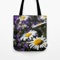 rileigh smirl Tote Bags featuring Field of Daisies by Rileigh Smirl