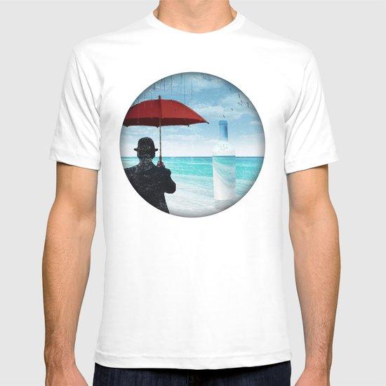 Chaplin at the beach in the rian T-shirt
