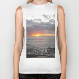 colorful sunset in new zealand on black sand Biker Tank