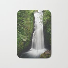 Beautifull mountain waterfall in a forest Bath Mat