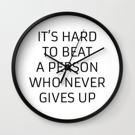 IT'S HARD TO BEAT A PERSON WHO NEVER GIVES UP - MOTIVATIONAL QUOTE Wall Clock