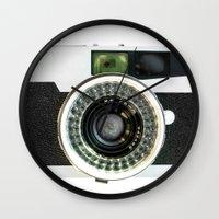 vintage camera Wall Clocks featuring Vintage camera by cafelab