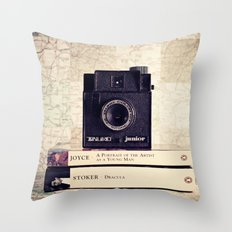 Vintage black camera and Joyce and Dracula books on Map pattern background  Throw Pillow