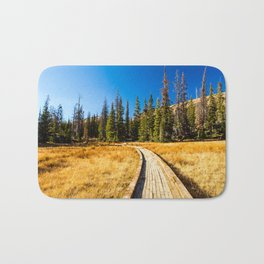 Wooden hiking trail in the forest Bath Mat