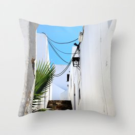 Typical white and narrow Greek street with stone stairs and blue sky Throw Pillow