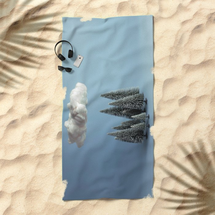 A cloud over the forest Beach Towel