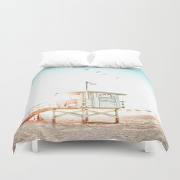 Pelicans Over the 10th Street Lifeguard Tower Duvet Cover