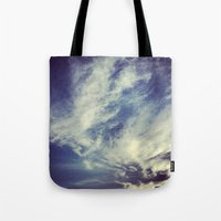 mexican Tote Bags featuring Mexican sky by Olivier P.