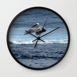 Flying pelican above the ocean Wall Clock
