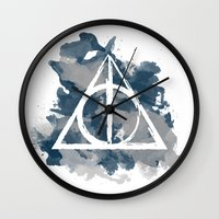 ravenclaw Wall Clocks featuring The Deathly Hallows (Ravenclaw) by FictionTea