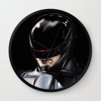 robocop Wall Clocks featuring RoboCop (2014) by Jamie Briggs