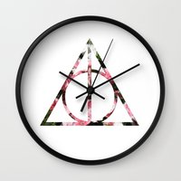 deathly hallows Wall Clocks featuring The Girly & Deathly Hallows by Enyalie