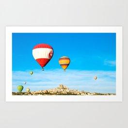 Colorful hot air balloons flying near Uchisar castle at sunrise, CappadociaTurkey Art Print