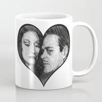 selena gomez Mugs featuring Morticia and Gomez by Jake Anthony