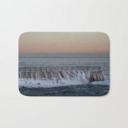 A Wave Tops the Seawall at Children's Pool, La Jolla, California. Bath Mat